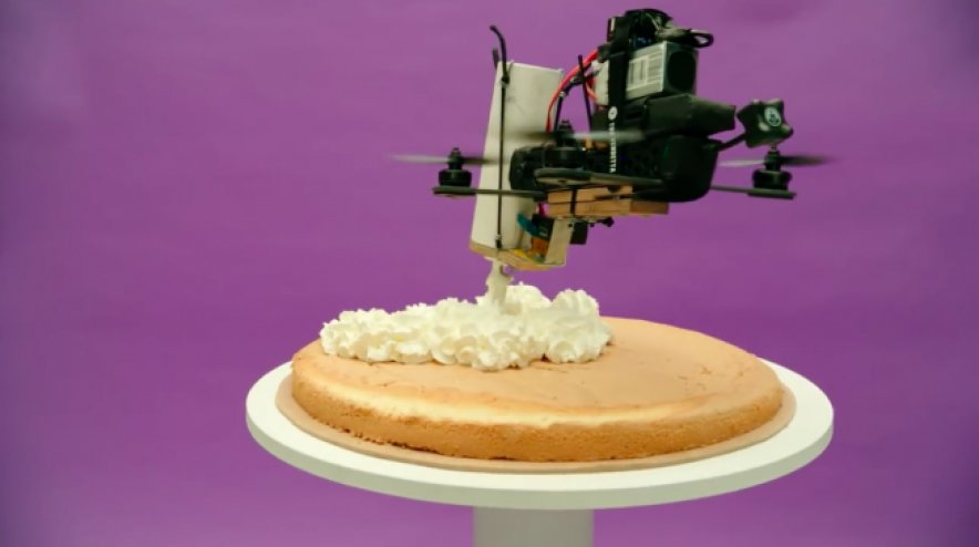 A cake decorated by drones